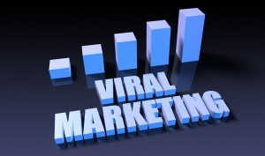 A 3-d graph chart rises on a black background. The words viral marketing are beneath it.