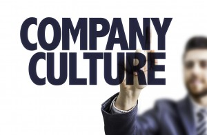 "A man has created the words ""Company Culture"" in the frame towards the viewer."